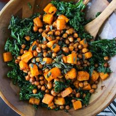 Chipotle roasted chickpeas and butternut squash salad over a bed of massaged kale and topped with a handful of pumpkin seeds.