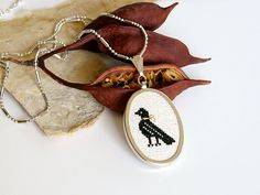 Hand Embroidery Necklace - Embroidered Pendant with chain - Cross Stitched Black Bird  with gold thread accent - Antique design