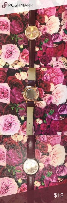 Burgendy women's watch Perfect condition watch. Only worn once. No signs of wear and tear. Rose gold face. Stainless steel back. Accessories Watches