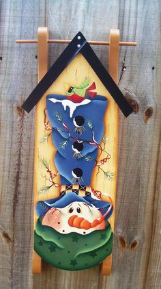 Snowman Sled, Winter, Birdhouse,  Sled, Wall Hanging, Seasonal, Home decor, Holidays. $32.95, via Etsy.