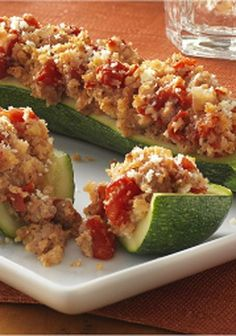 Italian Sausage Stuffed Zucchini is a delicious way to use zucchini that will be a hit at dinner or your next cookout!