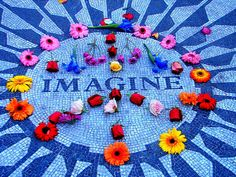 This was one of John Lennon's favorite spots in Central Park, (called 'Strawberry Fields'). After he  was killed, this mosaic was made as a tribute to him. The building he lived in (the Dakota) is across the street. Many times there are people playing Beatle songs on their guitars here, and on his birthday & anniversary, people gather and light candles.