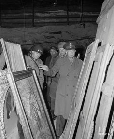 Supreme Allied Commander General Dwight D. Eisenhower inspects looted art treasures in a salt mine in Merkers, central Germany in April 1945.