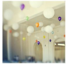 Balloons weighed down by records.