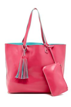 Tote your goodies around in style with this vibrant tassel-detailed handbag!