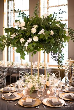 White, Green, and Gold Reception Table Decor at The Rainbow Room in New York City. Tall Flower Centerpieces, Table Flower Arrangements, Greenery Centerpiece, Tall Wedding Centerpieces, Wedding Decorations, White Wedding Flower Arrangements, Formal Wedding Decor, White Centerpiece, Wedding Table Centres