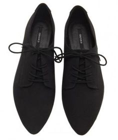 These pointed-toe canvas sneakers are like ballet flats in their most athletic form. The slim profile and tonal coloring offers a leg-lengthening effect suited for year-round wear.