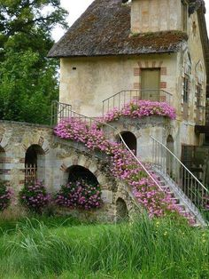 France.  A stairway with a necklace of flowers.