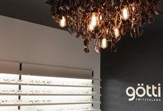 Götti store Lucerne, sunglasses chandelier, by Bureau Purée Zurich Visual Merchandising, Titanium Glasses, Lucerne Switzerland, Design Furniture, Stores, Chandelier, Ceiling Lights, Zurich, Retail Design