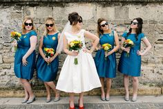 blue bridesmaids dresses - photo by Christina Karst Photography http://ruffledblog.com/retro-1960s-wedding-in-st-augustine