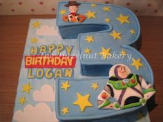 3 shape, with same colours, but with plastic characters surrounding it Toy Story Cake for Owens 3 rd birthday