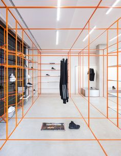 Storage Associati's Acquasalata store in Cattolica combines an edited palette of materials with clever use of coloured grids and strip lighting.