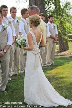 I love the men's suits actually n I love the tan and white for country wedding....hmmm