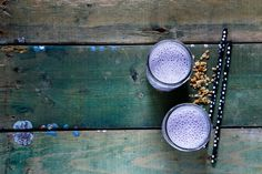 #Healthy berry smoothie  Fresh healthy berry smoothie in glass jars over rustic wood background top view selective focus. Healthy eating Detox or Diet concept