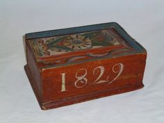 """Well decorated Swedish candle box from the town of Lima,Sweden. Dated 1829 and initialed """"FED"""" on the other side.Items from Lima from a school of artists.H.11cm.,W.26cm.,D.18cm ( 4in by 10in by 7in)"""