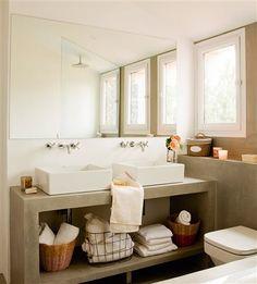Baño en microcemento con lavamanos doble