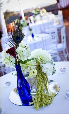 royal blue and peacock and a mason jar full of white flowers!