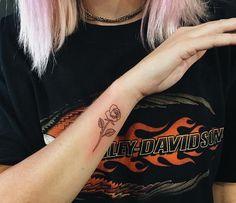 minimalistic flower tattoo