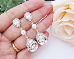 Wedding Bridal Jewelry Bridal Earrings Bridesmaid Earrings Cubic zirconia earrings with Clear White Swarovski Crystal and Pearls Tear drops. $31.80, via Etsy.