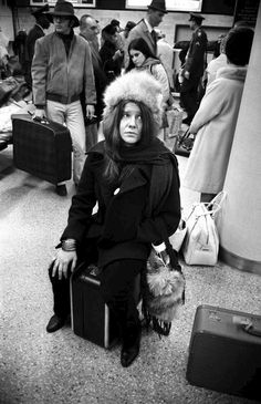 Janis looks alone and lonely, must be waiting for a flight or customs or something.