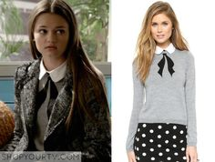 Emma Chota (Ciara Bravo) wears this grey ribbon collared sweater in this week's episode of Red Band Society. It is the Alice + Olivia Grey Ribbon Sweater. Buy it HERE for $330.00