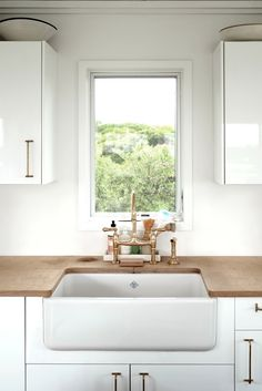 Interior Architecture, Detailing and Photography by Kevin Greenberg of Space Exploration. Kitchen Inspiration.  Farmhouse sink.  White Kitchen.  Eclectic Kitchen. Kitchen Sink.