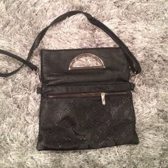 Black purse Worn couple times. Can be worn as a clutch or a shoulder bag. Pretty cool. Best of both worlds ;) still in a good condition the back side is missing a little piece to the zipper but it still zips up that's what matters other than that it's perfect inspired bag Bags