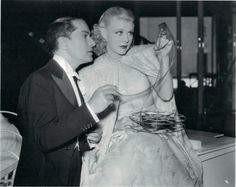 Ginger Rogers checking some film on the set of Swing Time