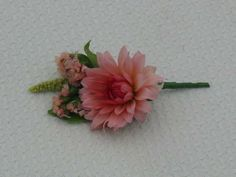 Buttonhole with Pink Dahlia and statice grown and made by Sussex Cutting Garden