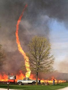 """Amazing picture of a """"fire tornado"""" this past weekend in Missouri. A """"fire tornado"""" is caused by intense heat from a fire combining with gusty winds to form eddies. These eddies can tighten up and eventually spin to form a """"tornado"""". Strange Weather, Extreme Weather, Fire Tornado, Wow Photo, Dame Nature, Wild Weather, Tornados, Image Of The Day, Mother Nature"""