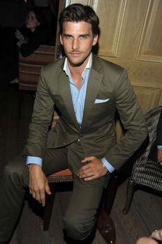 tan suit + blue/white shirt + pocket square + no tie