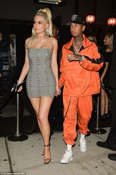 Ring confessions: Kylie Jenner came close to clearing up the rumours around THAT ring on her wedding finger as she and Tyga partied in New York on Thursday