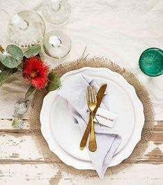 This is so pretty! Love the burlap with the red flower & green glass to accent it all! Very well done. #wedding #tablescape