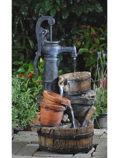 The Classic Water Pump Fountain With Led Light features a classic water spigot and tiers of flowing water. Lights illuminature this country inspired water feature making it a great choice for any outd