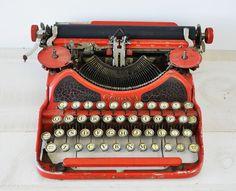 amazing antique Smith Corona 1926 MODEL 4 portable typewriter --- rare red color. $50.00, via Etsy.