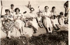 Ladies knitting on a sea wall.