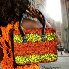 African print Bag This cute hobo tote bag is for the stylish woman. which means the bag is unique . The fabric African Ankara wax print from Liberia. The shell of the bag is a polyester/cotton blend a
