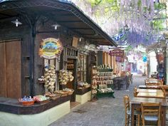 Lesvos: Petra street shaded by wisteria