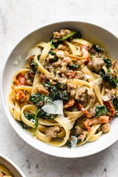 This creamy Tuscan sausage pasta is loaded with the good stuff like garlic, sun-. - This creamy Tuscan sausage pasta is loaded with the good stuff like garlic, sun-dried tomatoes, spi - Creamy Sausage Pasta, Sausage Pasta Recipes, Italian Sausage Pasta, Recipes With Sausage And Spinach, Recipes Using Italian Sausage, Recipes With Basil, Ground Italian Sausage Recipes, Meatless Pasta Recipes, Rigatoni Recipes