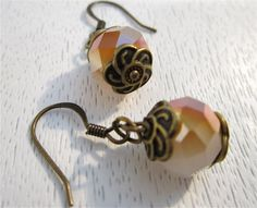 White and amber crystal glass bead earrings. $16.00, via Etsy.