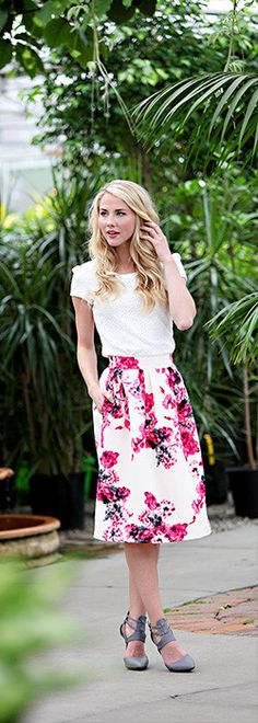 White shirt, white and pink floral skirt, gray heels.