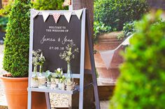 Jess & James - DIY Personalised Wedding Welcome Easel  Easel from Ikea, frame painted grey, and design stencilled onto blackboard.
