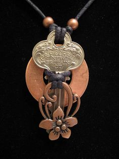 Items similar to urban artifact necklace - vintage key, copper washer, copper floral jewelry component, copper beads on Etsy