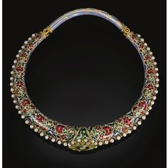 India   An enamelled and gem-set torque (hasli) of rigid ovoid from, with an applied diamond-set rosette to the centre and bridge and pin clasp, the upper side decorated with diamond flowerheads and leaves reserved against a blue enamelled ground, the reverse decorated in red, green, white and blue enamels with cartouches of alternating flowerheads flanked by birds, the edges bordered with pale blue enamelling and pearls   Jaipur, ca. 19th century
