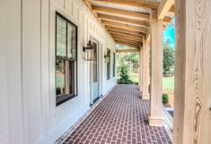 Tongue and groove porch ceiling; unfinished/clear sealant on notched out porch posts with clear yellow pine resting beam; board and batten exterior siding; pavers and brick accents; Custom Home Builders, Custom Homes, Modern Farmhouse, Farmhouse Style, Board And Batten Exterior, Farmhouse Front Porches, Country Porches, Farmhouse Windows, Exposed Rafters