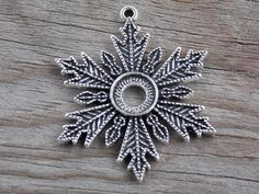 8 Silver Snowflake Pendants 46mm with 10mm Cabochon Setting Antiqued Silver by AliCsSupplyShop on Etsy