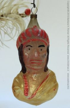 Heads and faces in glass; this one is an Indian head. (now called Native American)