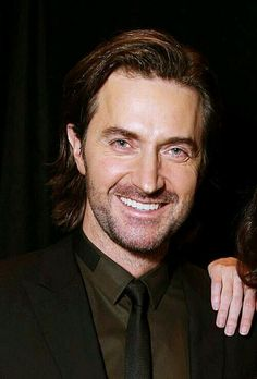 Richard Armitage, Cinema Con, 3/27/14, in Las Vegas  I keep telling  him  how wonderful he looks in brown...he's listening...to somebody...