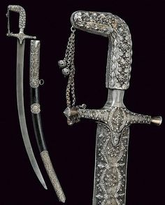 A silver mounted Saif. Curved, damask, single-edged blade with triple groove, silver hilt finely decorated with filigree, langets, straight quillons and angled pommel, double chain; wooden scabbard entirely covered with leather, silver mounts decorated en suite. Two suspension rings.  dating: 19th Century;   dimensions: 97.5 cm.;  provenance: Arabia