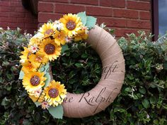 Handmade Sunflowers and rolled roses cover a Burlap wrapped wreath!  By Sue Ralph